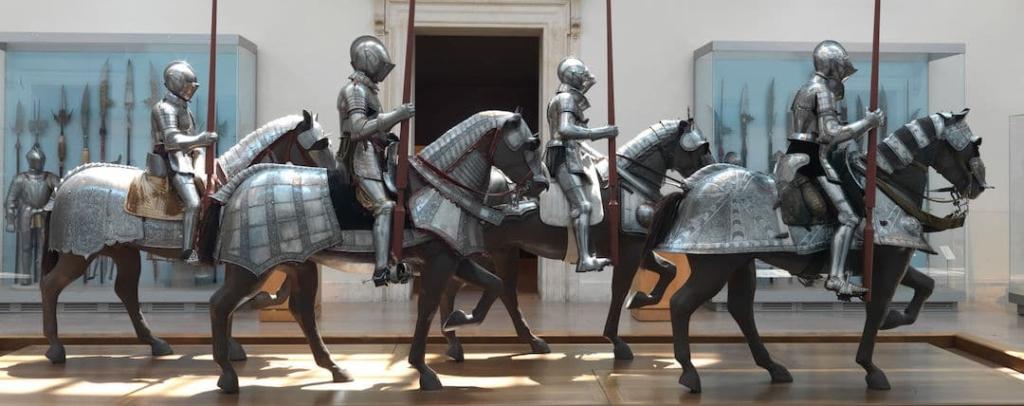 4 représentations d'hommes en armures du Moyen-Âge sur leurs chevaux.