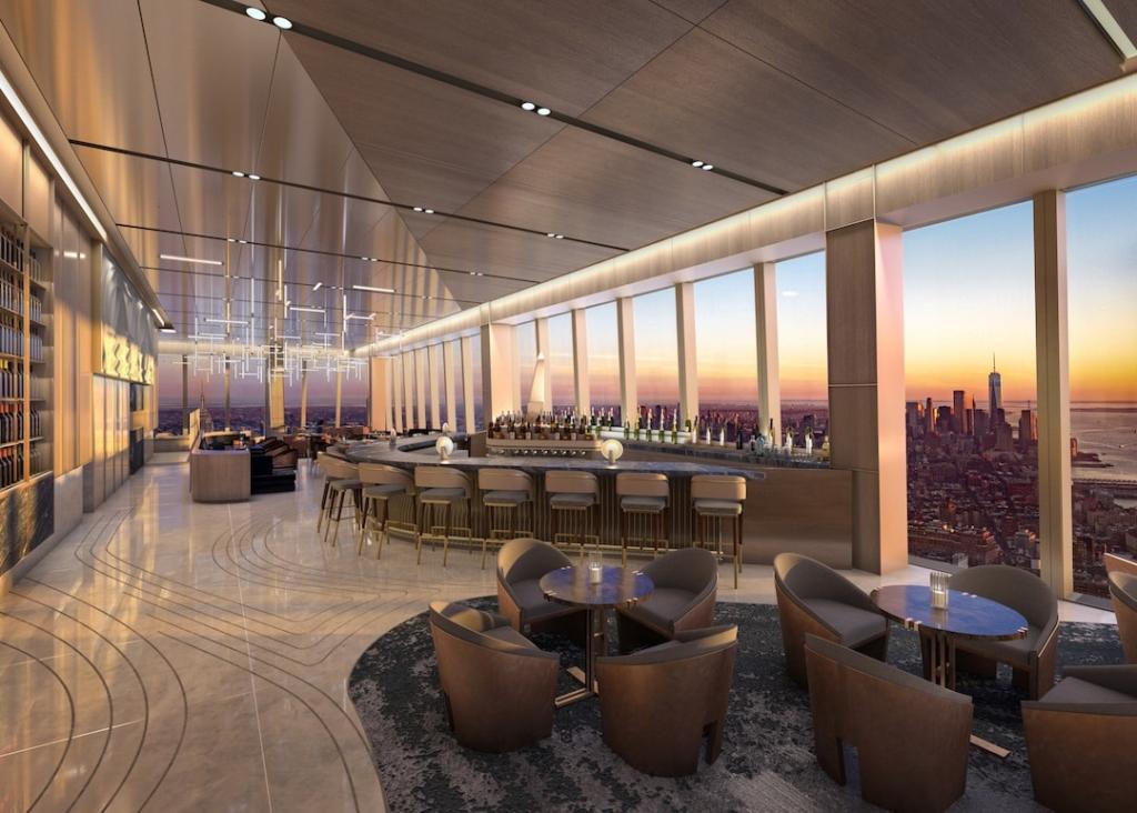 Restaurant haut de gamme avec vue sur tout New York au coucher de soleil.